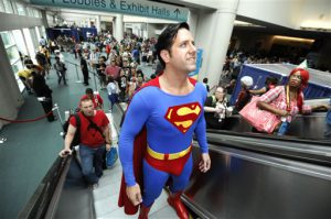 Trey Moore, dressed as Superman, rides the escalator on first day of Comic-Con convention held at the San Diego Convention Center on Thursday July 12, 2012, in San Diego.  (Photo by Denis Poroy/Invision/AP)