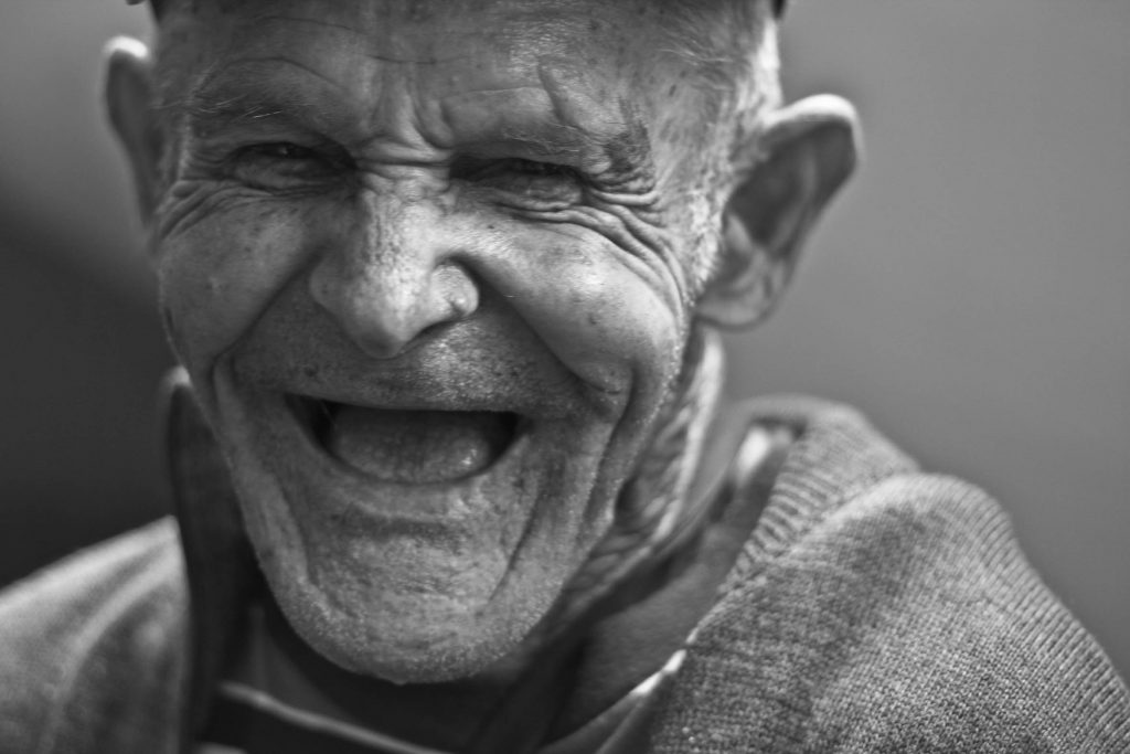 Portrait of an old man laughing